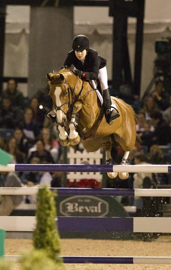 FEI World Cup Qualifier Grand Prix Wef 9, 3/9/13  Young American rider Katherine Dinan on Nougat Do Vallet. This horse competed in the London Olympic Games with a winning British rider! This little horse has lots of get up and go!!   Deborah Kalas Equestrian Photography