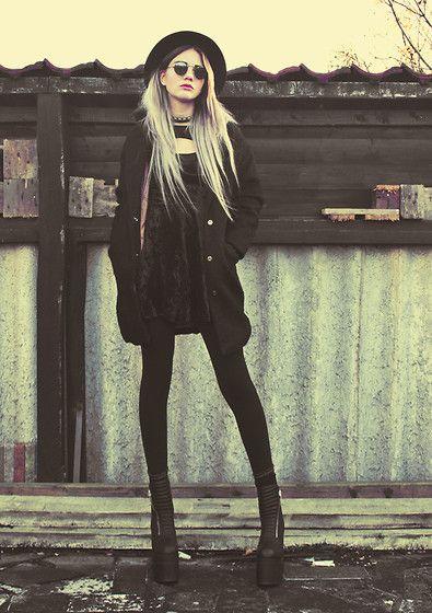 Urban grunge look with the black velvet dress, black tights, black platformed heels, black coat, round sunglasses, black brimmed hats, and colored hair for a dark grunge look.