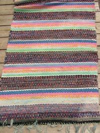 Wide Pink, Blue and Black Vintage Swedish Rag Rug    Product ID: RR1120    Vintage Swedish rag rug  Bold pattern of pastel blue, orange and pink stripes divided by wide black blocks  Completed with light blue cotton fringe  Long, wide rug  Size- 200 x 95cm