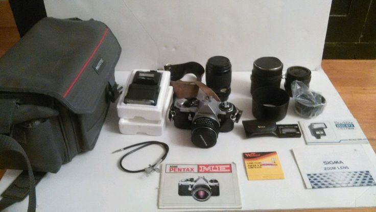 Pentax ME Super Camera with Sigma Zoom Lens, Focal 28mm lens, plus lots more