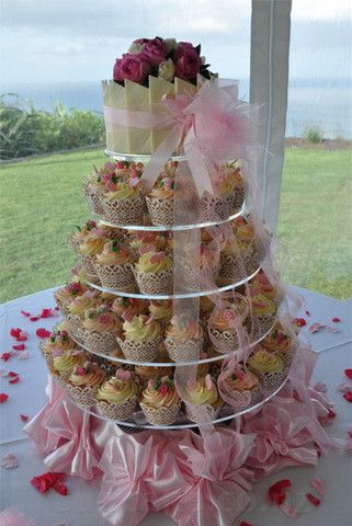 huge cupcake tiers with delicate white lace and white chocolate