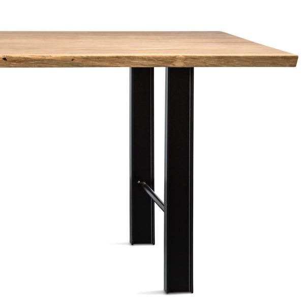 Shop the Track dining table by Bent Hansen. Solid oak planks sit atop a black trestle base for a striking, modern dining area. Offered in several large sizes.
