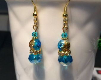 Lovely Swarovski glass crystal bead earrings in gold and blue tones. $9