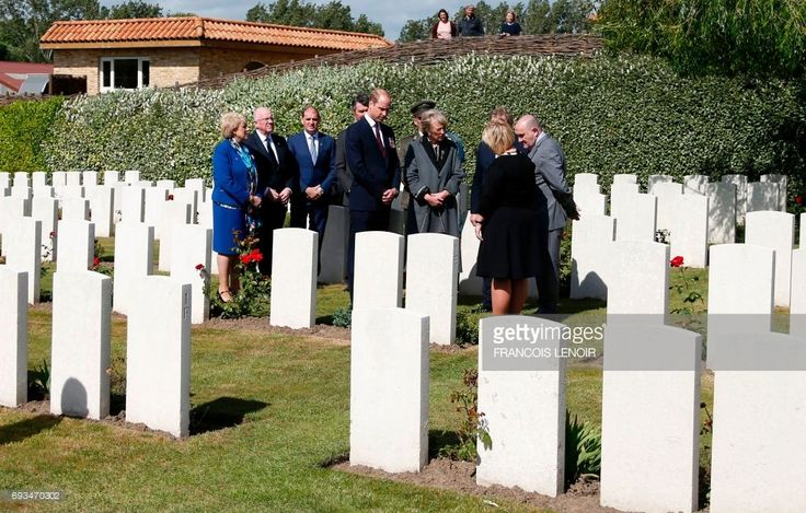 Britain's Prince William, Duke of Cambridge, Princess Astrid of Belgium and Irish Prime Minister Enda Kenny (hidden) arrive to attend a wreath-laying ceremony during the Battle of Messines Ridge commemorations at the military cemetery in Wijtschate, Belgium, on June 7, 2017. The Battle of Messines took place June 7-14, 1917 and was an offensive conducted by the British Second Army, during the First World War. LENOIR