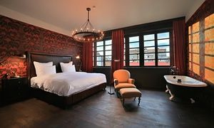 A spacious bedroom at Rooms Hotel