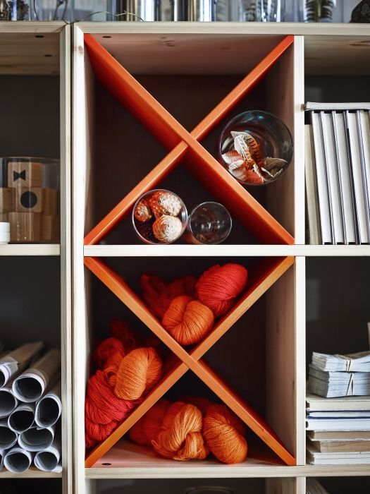 The NORNAS wine rack turns a normal shelf into creative and colorful storage.