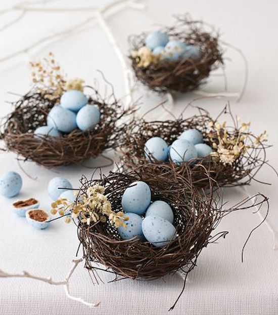 Mini chocolate eggs give an natural feel to any Easter table nestled in small twig nests. Handmade from natural angel hair grasses and dried flowers, these beautiful Easter decor items also make wonderful party favors, and are available at any craft shop. From Styleatthehome.com