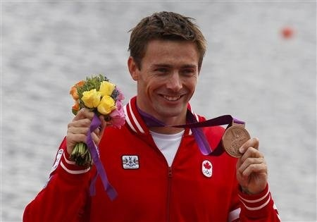 Mark Oldershaw of Canada reacts to his bronze medal after men's canoe single (C1) 1000m final at Eton Dorney at the London 2012 Olympics Games near London, August 8, 2012.