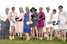 The mum-of-three was spotted at Aintree for the first day of the Grand National festival wearing a stunning Philip Armstrong dress