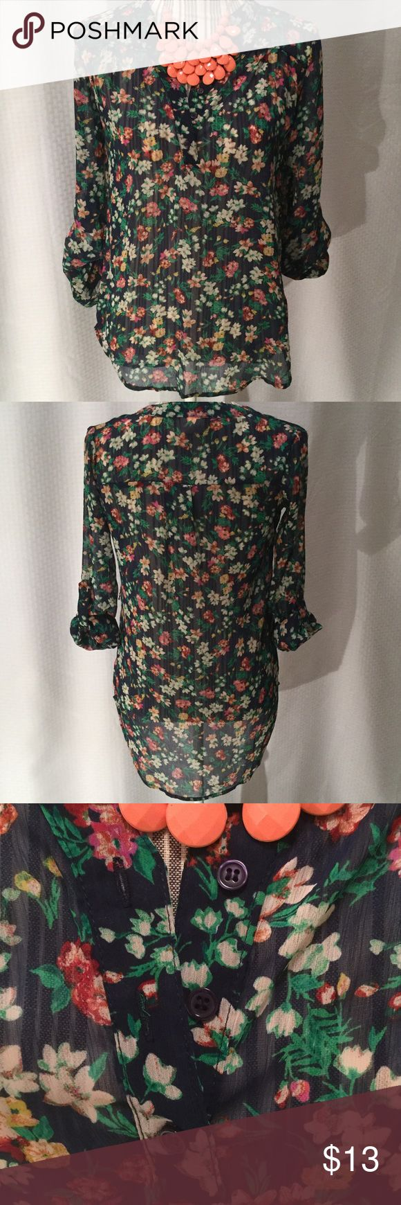 Cute high low flowered blouse  Mossimo brand. Size XS. Sheer so it will need a tank underneath. Has belt loops but I've never worn it with a belt. Sleeves roll up and button. Really cute shirt! Mossimo Supply Co Tops Blouses