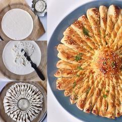 Een tarte soleil oftewel een zonnetaart. Gevuld met Boursin. Zeer geschikt voor de vrijdagmiddagborrel!