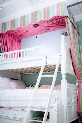 I've never seen a canopy over bunk beds before, but it's really pretty. A good way to dress up a space saving feature.