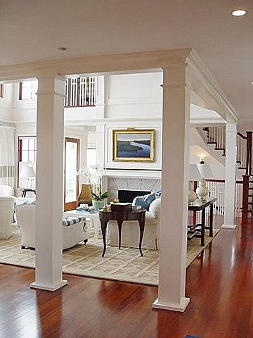 Interior columns connected w/ beam running along ceiling - SO CLEAN AND CLASSIC!!
