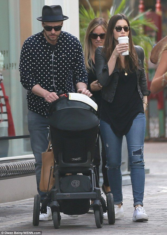 Baby's first Christmas: Jessica Biel and Justin Timberlake looked casually cool as they took their baby son Silas to visit Santa in Los Angeles, California, on Wednesday