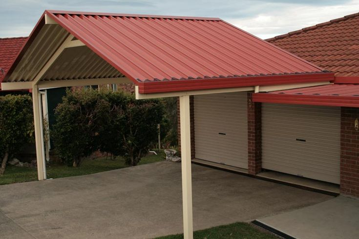 I love the look of that red metal roof on top of the patio ...