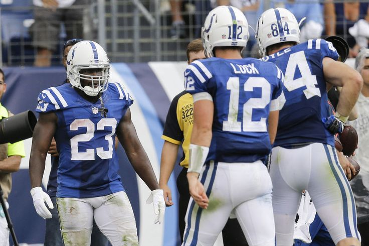 Indianapolis Colts running back Frank Gore (23) is congratulated by quarterback Andrew Luck (12) and tight end Jack Doyle (84) after Gore scored a touchdown on a 6-yard run against the Tennessee Titans in the second half of an NFL football game Sunday, Sept. 27, 2015, in Nashville, Tenn. (AP Photo/James Kenney)