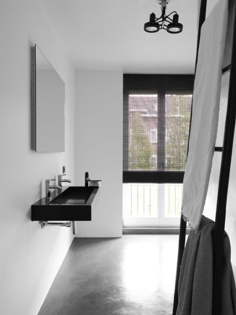Minimalist black and concrete bath room