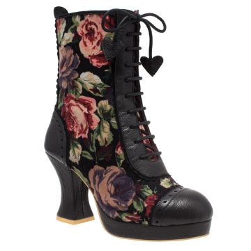 Blooming Lovely | Irregular Choice We LOVE this new boot! Vintage styling, floral printed and punched leather trims. There is a lace along the front of the boot finished with cute hearts at the end of each lace. There is a zip opening on the inside of the ankles. A curved block heel and platform make this perfect vintage IC!
