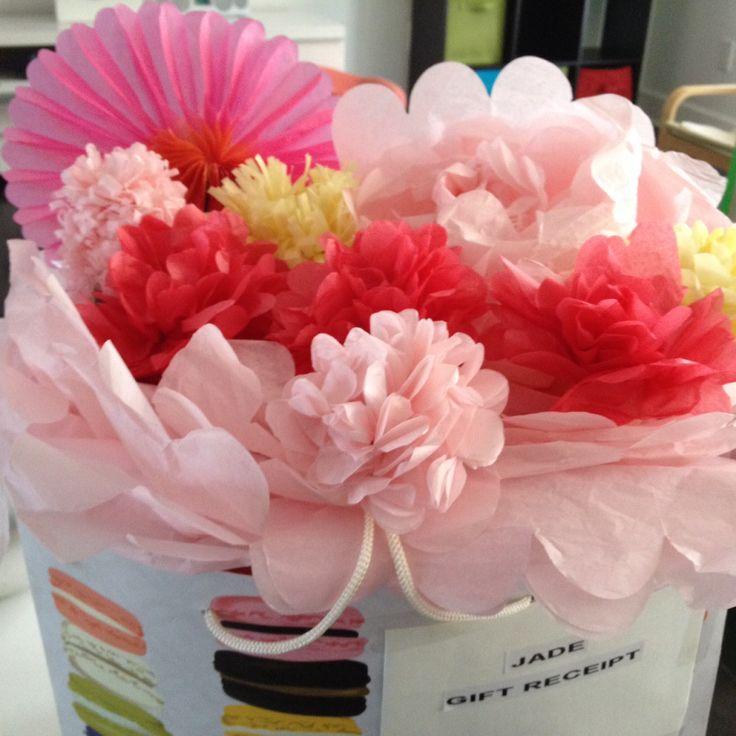Tissue paper flowers instead of sheets of tissue paper !! I thought this would be a nice twist for gifts in a bag!