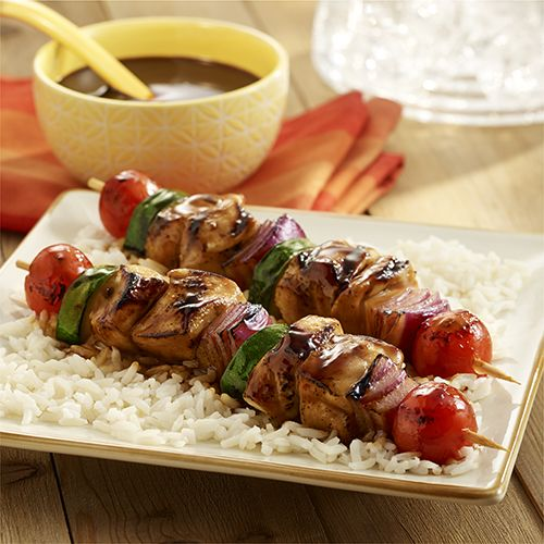 Grilled chicken recipe with vegetables on skewers is brushed with an Asian sauce and served with jasmine rice for a quick main dish.    Uncle Ben's® and Ready Rice® are registered trademarks of Mars Food US, LLC