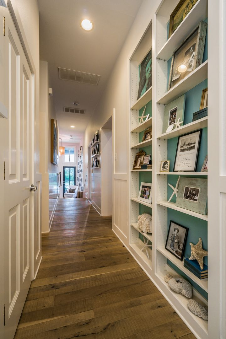 hallway with turquoise shelves | Van Wicklen Design