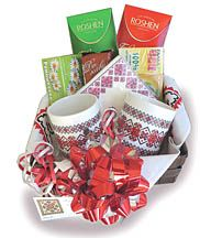 """The Perfect Gift! Tea for Two Gift Basket - Two embroidered mugs, a package of cocktail size embroidery napkins, two boxed herbal teas from Ukraine, a packet of """"Do Kavy"""" cookies and two 100g Elegance chocolate bars arranged in a sturdy basket lined with an embroidery design cloth servetka. Our most popular gift basket!"""