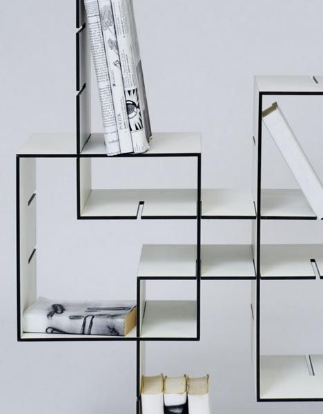 Slotted boxes that you can rearrange to make various shelves.  #storage #shelves #transformer