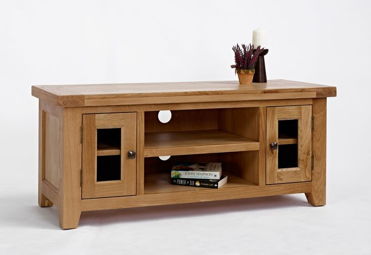 Devon Oak Large TV Unit The Devon Oak Large TV Unit would blend with a vast range of interior settings and would be a versatile investment for any home. Crafted using traditional methods, this piece features unique tapered l http://www.MightGet.com/january-2017-13/devon-oak-large-tv-unit.asp