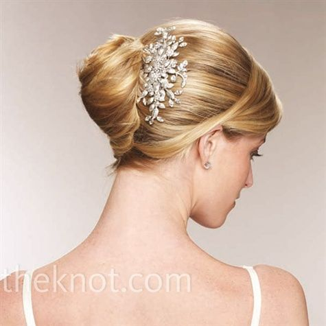 French Twist  Add a touch of sparkle to this structured updo with hairpins.