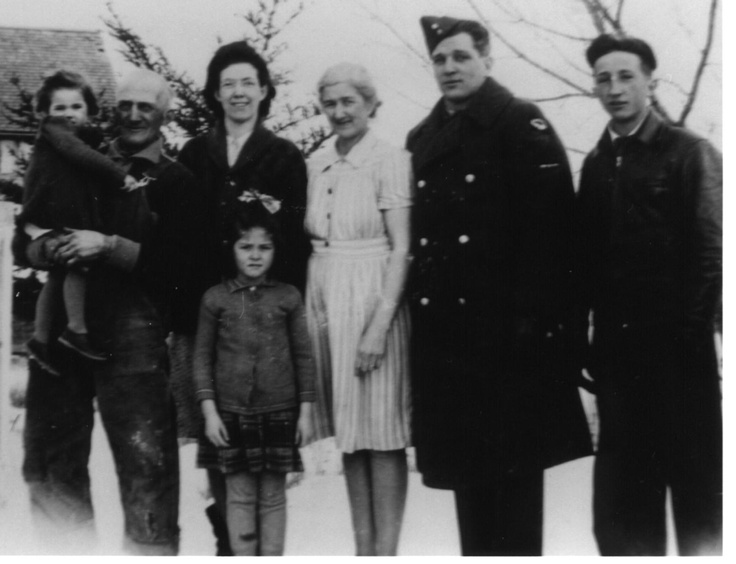 Dad, Orval Cummins (far right), Grandmother Mabel Cummins (center), and Grandfather Jackson Cummins (far left).