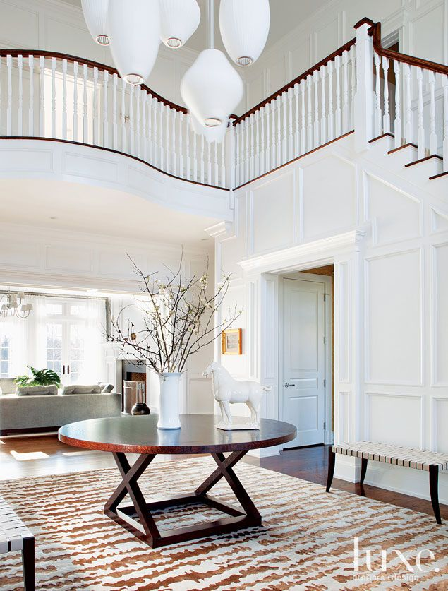 McDonough Conroy Architects Designed The Double Height Ceilings In This Foyer Where NR Design Group Placed A Walnut Stained Victoria Hagan Table And