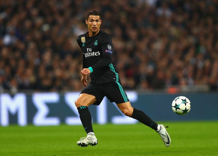 Cristiano Ronaldo Photos - Cristiano Ronaldo of Real Madrid in action during the UEFA Champions League group H match between Tottenham Hotspur and Real Madrid at Wembley Stadium on November 1, 2017 in London, United Kingdom. - Tottenham Hotspur v Real Madrid - UEFA Champions League