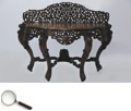 A very fine carved Indian teakwood serpentine console table, with cabriole legs with lion-head carvings on the top, c.1860.     54 in L x 22 in B x 41 in H