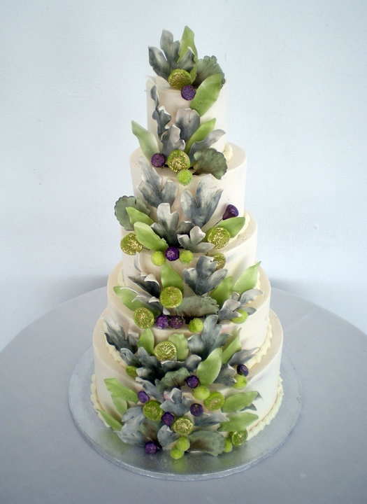 White, green and hints of purple wedding cake