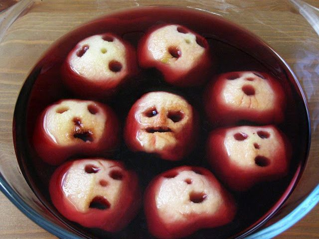 Shrunken Heads Punch - Carve the apples and dehydrate them in the oven on low temp. Dye the punch or juice red. Lovely