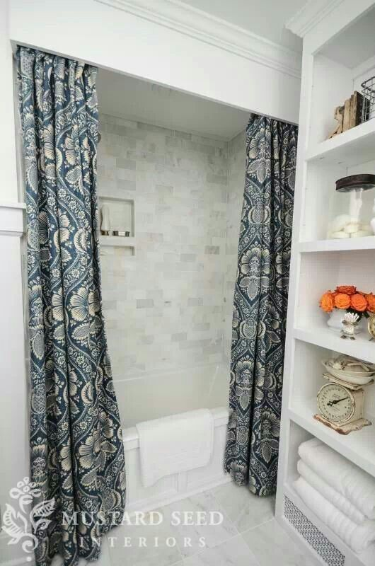High shower curtain....  one shower curtain cut in two? Maybe even add a valence (made from a solid color curtain) above to hide the rod...