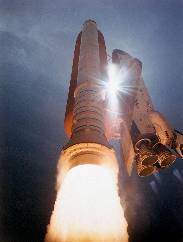 The Space Shuttle Atlantis streaks skyward as sunlight pierces through the gap between the orbiter and ET assembly. Atlantis lifted off on the 42nd space shuttle flight at 11:02 a.m. EDT on August 2, 1991 carrying a crew of five and TDRS-E. A remote camera at the 275-foot level of the Fixed Surface Structure took this picture.