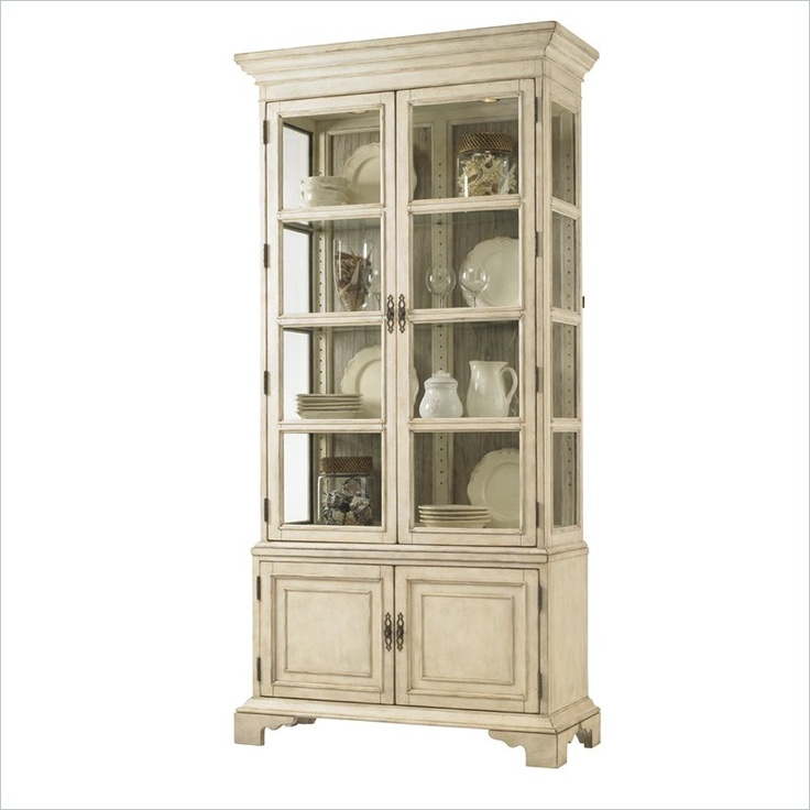 Lexington Twilight Bay Pierpoint Display Cabinet -  Features: Antique Linen finish – generously distressed white crackle with rub-through to a slate coloration (exterior)  Driftwood finish – soft taupe-gray color applied to a panel that has been textured to create a weathered effect (interior). Features a reversible Antique Linen or Driftwood back panel. 2 antique glass doors with 3 adjustable glass shelves  Glass shelves grooved for plates  Antique glass end panels