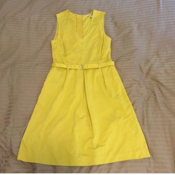 SOLD! NWOT Mustard Yellow Fit n Flare Dress Sz 6P Amazing fit and flare dress in a mustard/golden yellow (the dress is much more mustard color in person vs. the pictures). Never worn! This is a reposh for me, the dress didn't suit my skin tone as well as I would have liked. Great rayon jersey fabric with some stretch. Would look fantastic with some polka dotted heels or a blazer. Banana Republic Dresses Asymmetrical