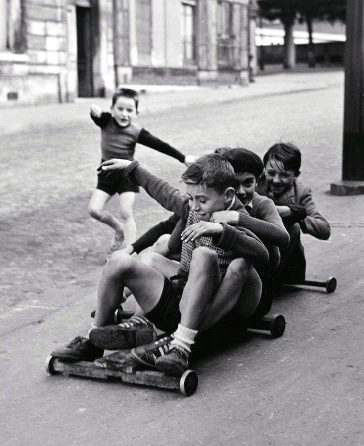 Sabine Weiss, Paris, 1952.   Boys riding on go cart.