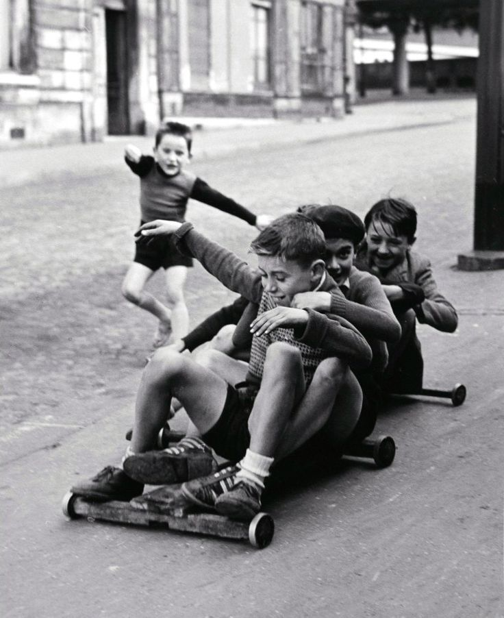 Sabine Weiss, Paris, 1952.   Boys riding on go cart.