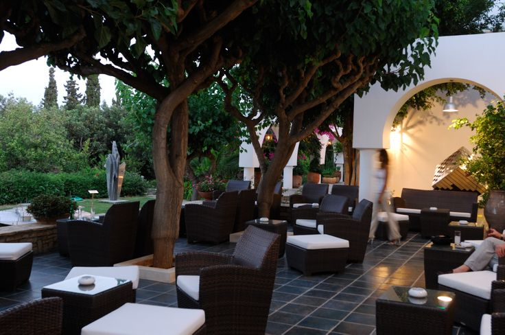 Lounge in the gardens on Minos Beach art hotel Crete