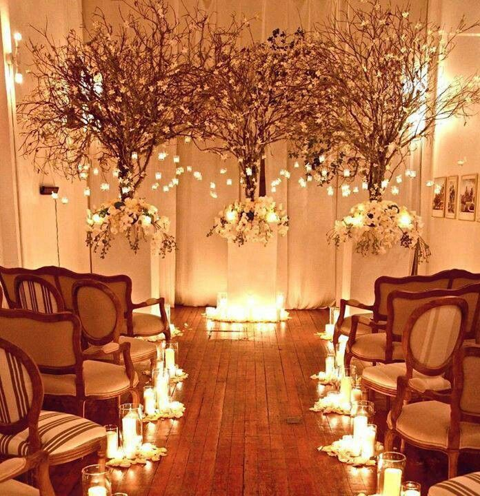"""Clusters of candles and """"snow"""" by each row. Winter wonderland, floral wedding concept."""