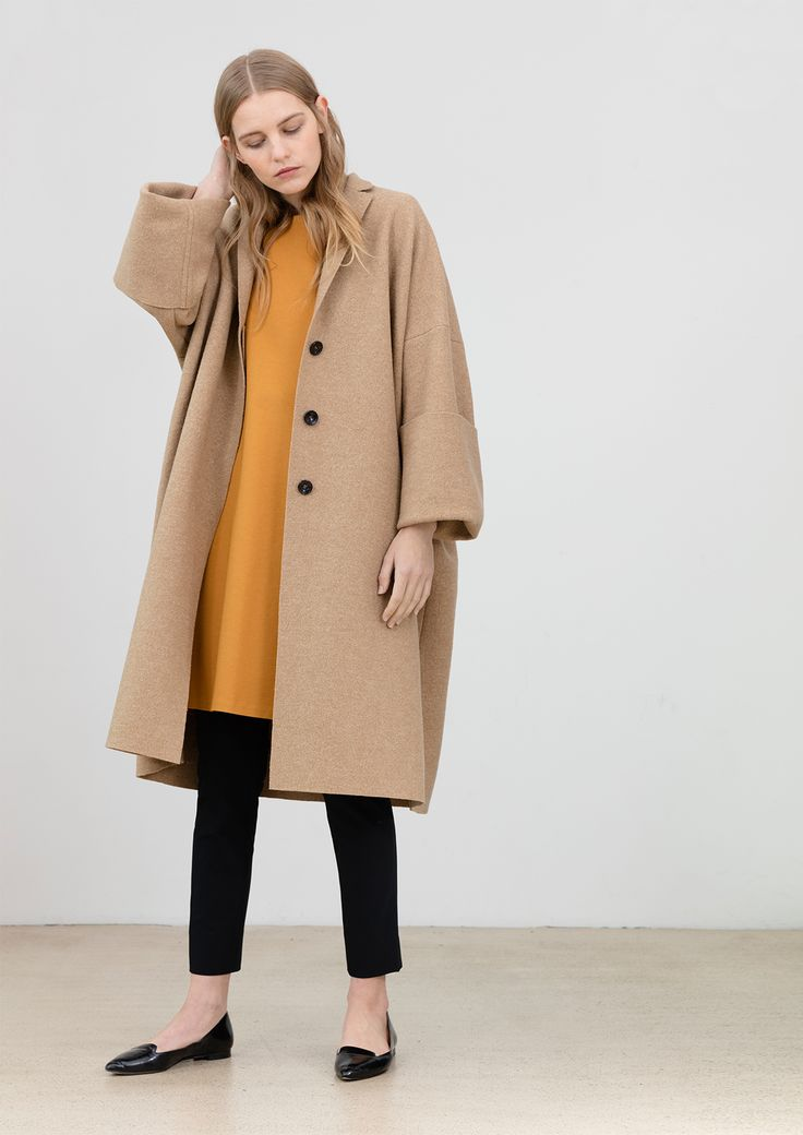 Oversize coat out of wool in camel, but available also in other colors, 3 / 4 sleeves dress in mustard out of high quality viscose, pa and jersey, and slim fit trousers in black with high waist, out of pa, ea bi-stretch #simpelthen #purity & #style #handmade in #switzerland