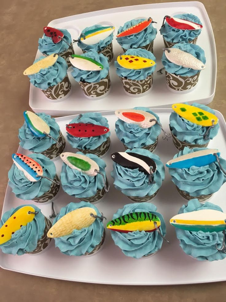 Chocolate cupcakes with salted caramel buttercream and modeling chocolate/fondant hand painted fish hooks