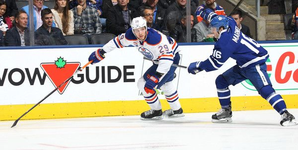 Leon Draisaitl Photos Photos - Leon Draisaitl #29 of the Edmonton Oilers skates against Mitchell Marner #16 of the Toronto Maple Leafs during an NHL game at the Air Canada Centre on November 1, 2016 in Toronto, Ontario, Canada. The Leafs defeated the Oilers 3-2 in overtime. - Edmonton Oilers v Toronto Maple Leafs