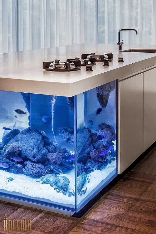 Moderna isla de cocina con acuario en su interior / Robert Kolenik http://www.arquitexs.com/2015/03/moderna-isla-de-cocina-con-acuario.html