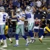 Dallas Cowboys punter Brian Moorman (2) and John Phillips (89) celebrate after kicker Dan Bailey (5) kicked a field goal to beat the Pittsburgh Steelers 27-24 in overtime of an NFL football game Sunday, Dec. 16, 2012 in Arlington, Texas. Pittsburgh Steelers' Josh Victorian (35) leaves the field. (AP Photo/LM Otero)