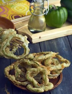 A perfect tea-time snack, these Capsicum Rings are made by deep-frying capsicum rings coated with a plain flour batter that is aptly perked up with black pepper.