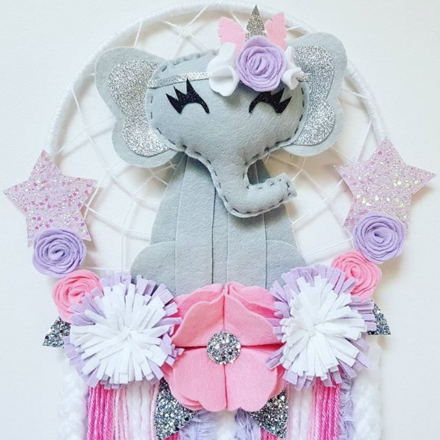 Elegant Elephant Dream Catcher Now up for sale in the etsy shop  $50 plus $12 Postage 225mm Hoop With pretty pink, purple and white flowers #elephant #elephantdecor #girlsdecor #dreamcatcher #dreamcatchers #feltflowers #felt #australianhandmade #etsyau #girlsroom #babyshowergift #nursery #girlsroomdecor #kidsdeco #etsylent #etsy